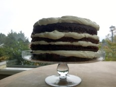 Imperfectly perfect. Sour cream chocolate layers and whipped cream cream cheese frosting. Yum!