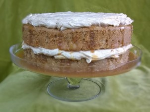 A casual, rustic presentation of the Cinnamon Apple Cake with Salted Caramel and Browned Butter Frosting for a family dinner.