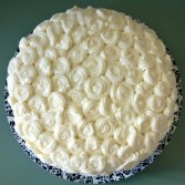 Swirls and swirls of rich cream cheese frosting on a luscious red velvet cake.