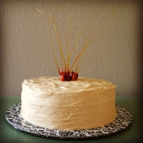 Luscious, simple, classic: tender and moist caramel cake is iced with browned butter frosting, which is nutty, a wee bit salty, and sweet. Candied almonds add festive notes to offset the simple aesthetic of the cake.