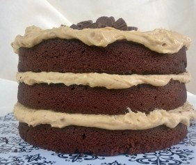 Moist chocolate cake and crunchy peanut butter frosting, Reese's peanut butter cups piled on top.