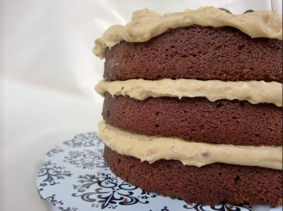 Thick blankets of peanut butter frosting between layers of moist chocolate cake.