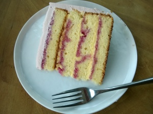 Lemon Cake soaked with blackberry syrup, French lemon cream filling, and blackberry buttercream.