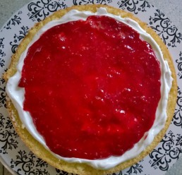 Freshly made raspberry filling, with the floral notes of lemon zest, brings brightness and riotous color to the cake.