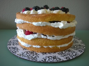 Genoise Cake soaked in Earl Grey syrup, softly sweetened whipped cream, and fresh raspberries and blackberries